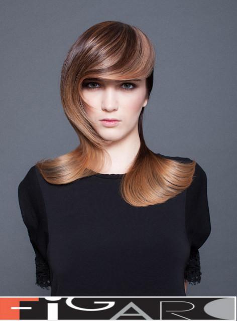 Asymmetrical long hair cut by Figaro Hair Salon Toronto