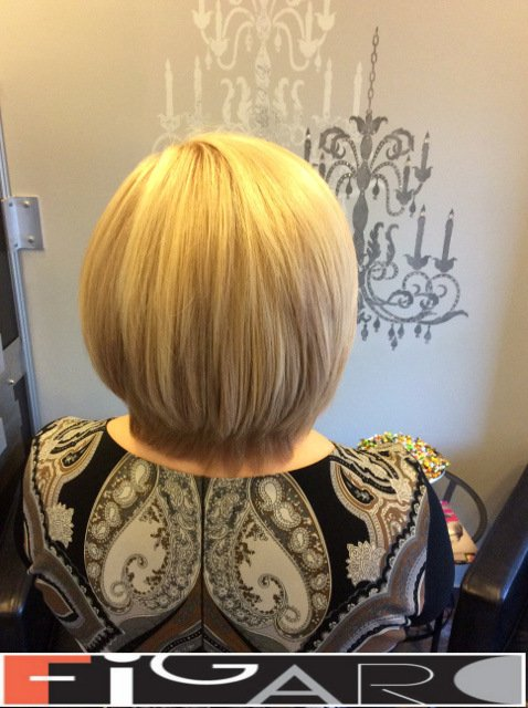 Blonde hair with Platinum Highlights by Figaro Hair Salon Toronto